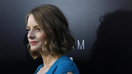 """Jodie Foster poses at the world premiere of """"Elysium"""" in Los Angeles"""