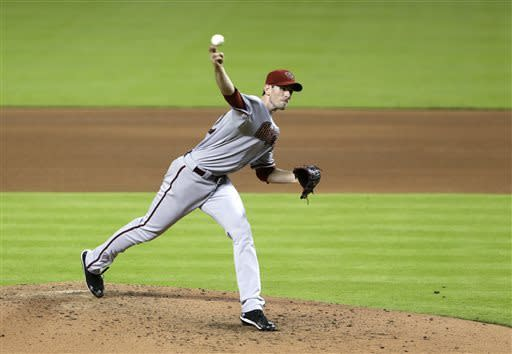 Arizona Diamondbacks' Brandon McCarthy delivers a pitch during the fifth inning of a baseball game against the Miami Marlins, Saturday, May 18, 2013 in Miami. McCarthy pitched a three-hit complete-game shutout for his first win since being struck in the head by a line drive last season in the Diamondbacks' 1-0 victory over the Marlins. (AP Photo/Wilfredo Lee)
