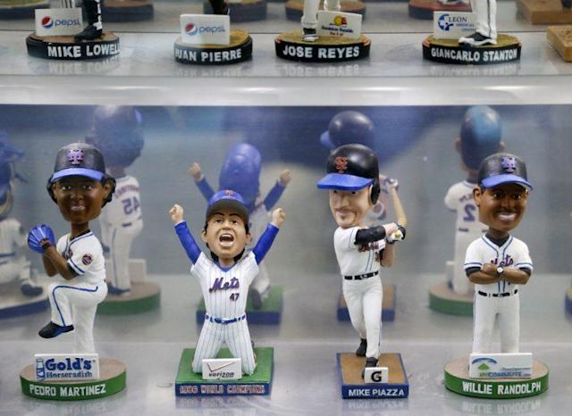 Bobbleheads on display at the Miami Marlins Bobblehead Museum at Marlins Park. Many of these bobbleheads were MLB team giveaways. (AP)