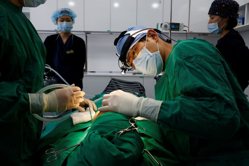 Park Cheol-woo a director of WooAhIn Plastic Surgery Clinic conducts a nose plastic surgery of Ryu Han-na, amid the coronavirus disease (COVID-19) pandemic in Seoul