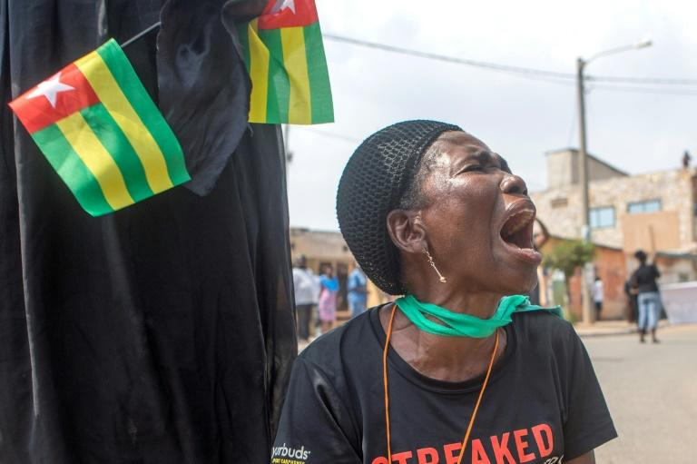 An anti-Gnassingbe demonstration in Lome in 2018. Weekly opposition protests eventually petered out, leaving Gnassingbe firmly in control. (AFP Photo/Yanick Folly)