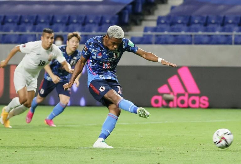Japan's Ado Onaiwu opens the scoring with a penalty in the 5-1 win against Kyrgyz Republic in Suita