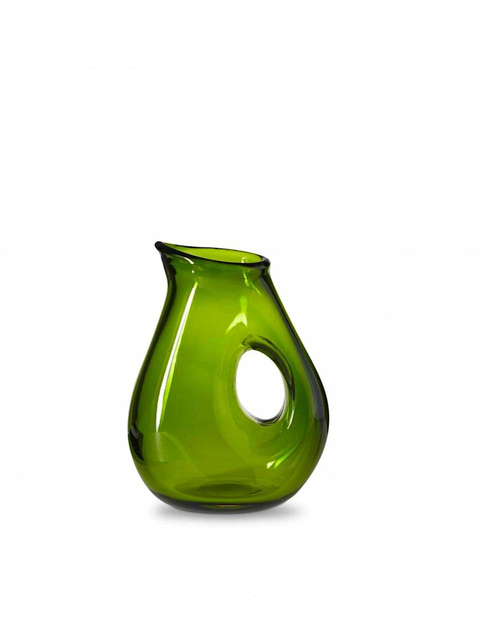 """This olive green, curvaceous jug with its chunky handle feels organic, like something you might come across in a garden. $35, Merci. <a href=""""https://www.merci-merci.com/en/pichet-olive.html"""" rel=""""nofollow noopener"""" target=""""_blank"""" data-ylk=""""slk:Get it now!"""" class=""""link rapid-noclick-resp"""">Get it now!</a>"""