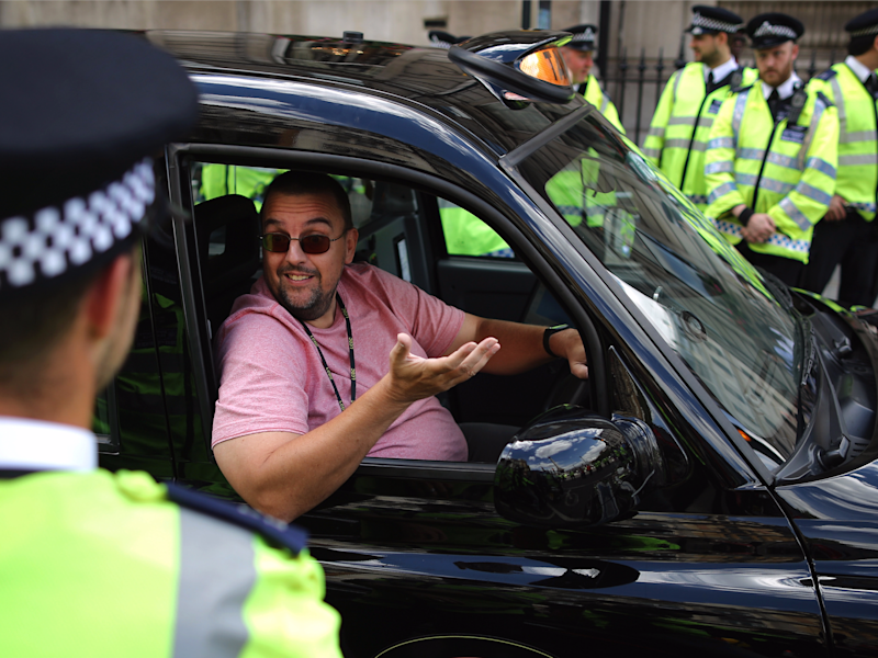 taxi driver london black cabbie police uber protest