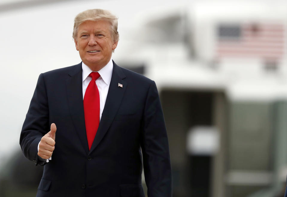 President Donald Trump gives thumbs up as he boards Air Force One as he departs Wednesday, Oct. 11, 2017, at Andrews Air Force Base, Md., as he travels to Harrisburg, Pa. (AP Photo/Alex Brandon)