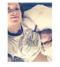 """<p>Wearing a shirt that says, """"Never Underestimate the Power of a Woman,"""" the new mom recently shared a picture of new baby, Daisy nursing. <i>(Instagram/<a href=""""https://www.instagram.com/oliviawilde/"""" rel=""""nofollow noopener"""" target=""""_blank"""" data-ylk=""""slk:oliviawilde"""" class=""""link rapid-noclick-resp"""">oliviawilde</a>)</i></p>"""
