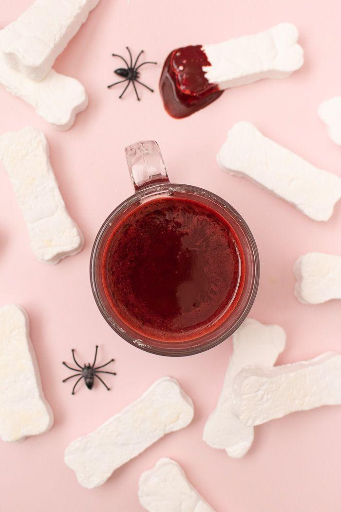 """<p>Warm up with this red velvet cocoa, topped with bones, of course. Count Dracula would approve. (You can also go ahead and spike it with rum.)</p><p><a class=""""link rapid-noclick-resp"""" href=""""https://www.clubcrafted.com/marshmallow-bones-red-velvet-hot-chocolate/"""" rel=""""nofollow noopener"""" target=""""_blank"""" data-ylk=""""slk:GET THE RECIPE"""">GET THE RECIPE</a></p>"""
