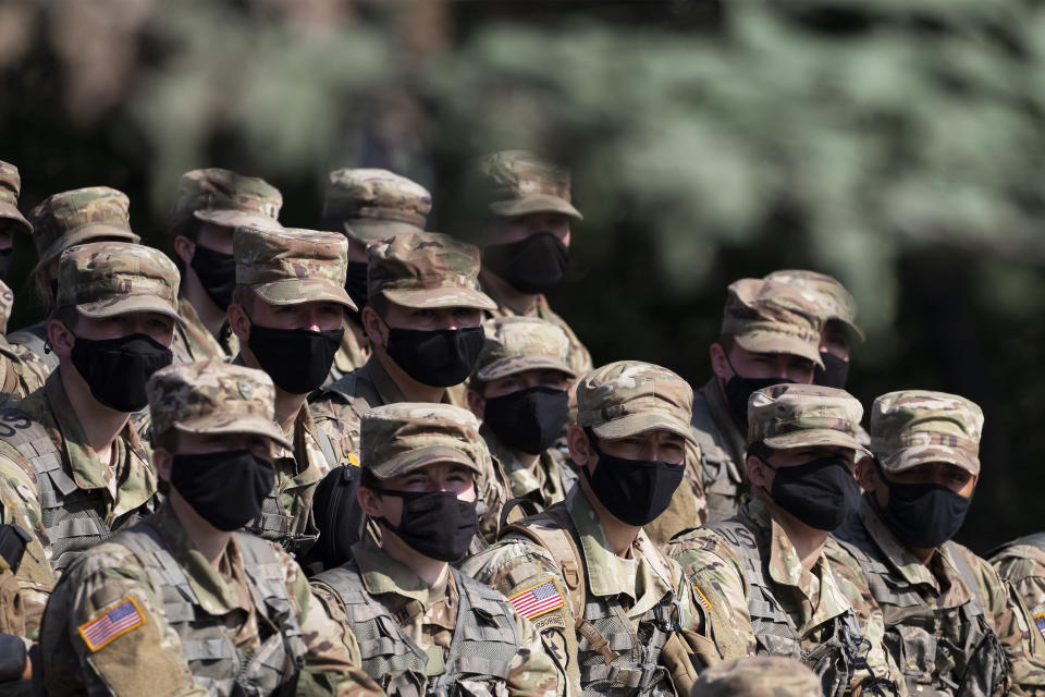 Cadets wear masks as they listen to instructions on firing mortars, Friday, Aug. 7, 2020, at the U.S. Military Academy in West Point, N.Y. (AP Photo/Mark Lennihan)