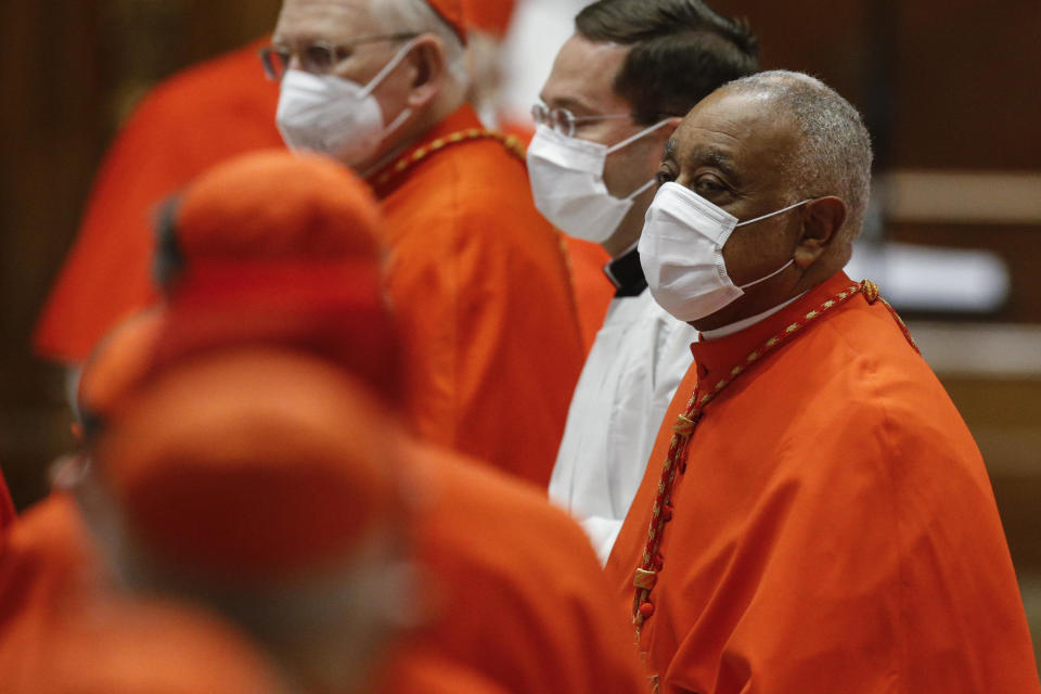 American newly appointed Cardinal Wilton D. Gregory attends a consistory ceremony where 13 bishops were elevated to a cardinal's rank in St. Peter's Basilica at the Vatican, Saturday, Nov. 28, 2020. (Fabio Frustaci/POOL via AP)