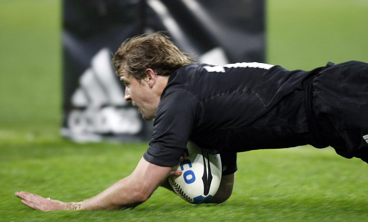 New Zealand fly half Nick Evans scores a try during the rugby union international match between New Zealand and France at Eden Park in Wellington, 09 June 2007. New Zealand defeated France 61-10. AFP PHOTO / DAMIEN MEYERNew Zealand fly half Nick Evans scores a try during the rugby union international match between New Zealand and France at Eden Park in Wellington, 09 June 2007. New Zealand defeated France 61-10. AFP PHOTO / DAMIEN MEYER (AFP Photo/DAMIEN MEYER)