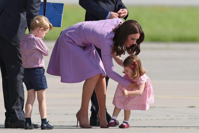 Princess Charlotte is helped up by the Duchess of Cambridge after she fell over during a visit to Germany (Jane Barlow/PA)