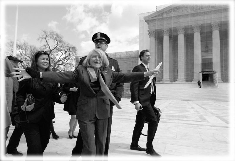 Plaintiff Edith Windsor of New York, reacts as she looks toward supporters in front of the Supreme Court in Washington, after the court heard arguments on the Defense Against Marriage Act (DOMA) on March 27, 2013. (Photo: Jose Luis Magana/AP; digitally enhanced by Yahoo News)