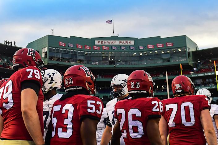 The Harvard Crimson and the Yale Bulldogs shake hands after a game at Fenway Park on November 17, 2018, in Boston. / Credit: Adam Glanzman / Getty