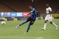 Inter Milan's Ashley Young scores his side's opening goal during a Serie A soccer match between Inter Milan and Torino, at the San Siro stadium in Milan, Italy, Monday, July 13, 2020. (AP Photo/Luca Bruno