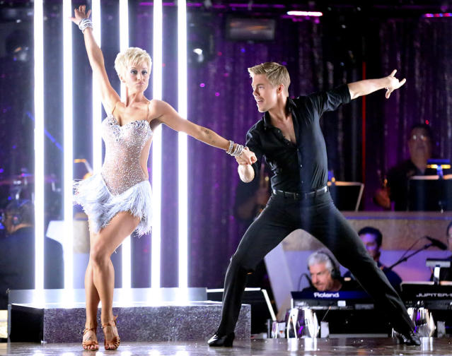 "Kellie kicked off Week 1 of the competition with a cha-cha and an open-back, fringed-skirt bodysuit, but it was her pixie haircut that had people talking. (The county singer shaved her head to support cancer awareness and support a friend who was battling the disease.) When her pro partner, Derek Hough, joked about their matching 'dos, Kellie said, ""I'll be your Tinkerbell, and you can be my Peter Pan."""