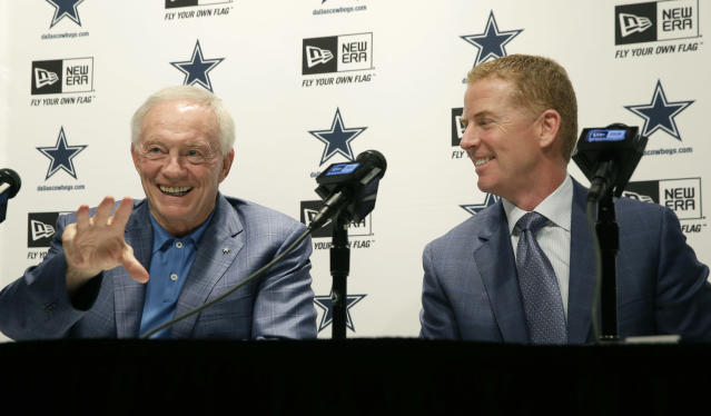 Dallas Cowboys owner Jerry Jones, left, talks about the team's NFL football draft as head coach Jason Garrett looks on at Valley Ranch in Irving, Texas, Saturday, May 10, 2014. (AP Photo/LM Otero)