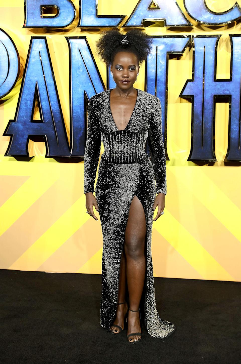 <p>The Oscar-winning actress worked a plunging, metallic dress by French fashion house Balmain. <em>[Photo: Getty] </em> </p>