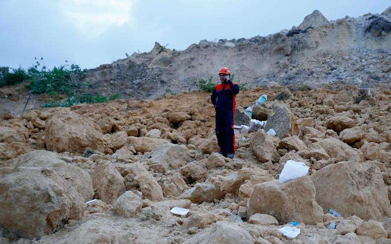 The landslide buried dozens of homes in Naga city, Cebu province in the Philippines - AP