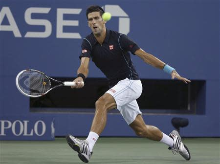 Novak Djokovic of Serbia returns a forehand to Joao Sousa of Portugal at the U.S. Open tennis championships in New York, September 1, 2013. REUTERS/Adam Hunger