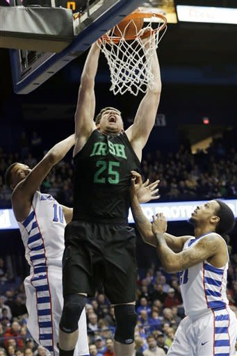 Notre Dame forward Tom Knight (25) dunks as DePaul center Derrell Robertson Jr., (10) and guard Jamee Crockett (21) guard during the first half of an NCAA college basketball game in Rosemont, Ill., on Saturday, Feb. 2, 2013. (AP Photo/Nam Y. Huh)