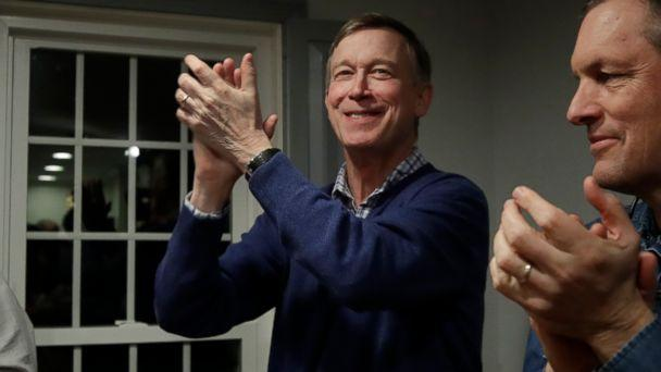 PHOTO: Former Colorado Gov. John Hickenlooper, left, applauds at a campaign house party, Feb. 13, 2019, in Manchester, N.H. (Elise Amendola/AP)