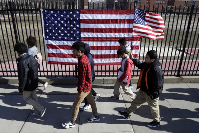<p>Students from James Ferris High School march outside of the school during a student walkout, Wednesday, March 14, 2018, in Jersey City, N.J. Young people in the U.S. walked out of class to demand action on gun violence Wednesday in what activists hoped would be the biggest demonstration of student activism yet in response to last month's massacre in Florida. (Photo: Julio Cortez/AP) </p>