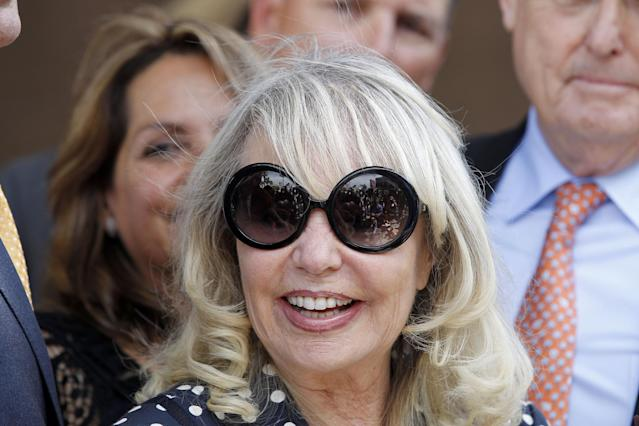Shelly Sterling smiles as she talks to reporters after a judge ruled in her favor and against her estranged husband, Los Angeles Clippers owner Donald Sterling, in his attempt to block the $2 billion sale of the NBA basketball team, outside Los Angeles Superior Court, Monday, July 28, 2014. (AP Photo/Nick Ut)