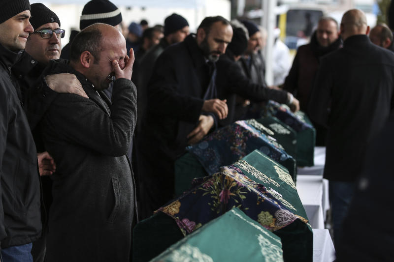 "Mourners attend the funeral prayers for nine members of Alemdar family killed in a collapsed apartment building, in Istanbul, Saturday, Feb. 9, 2019. Turkey's President Recep Tayyip Erdogan says there are ""many lessons to learn"" from the collapse of a residential building in Istanbul where at least 17 people have died.(AP Photo/Emrah Gurel)"