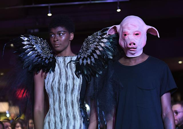 "The #MeToo fashion show ended with models walking out with their ""pigs,"" referring to the French equivalent of #MeToo, ""balance ton porc,"" or ""expose your pig."" (Photo: Getty Images)"