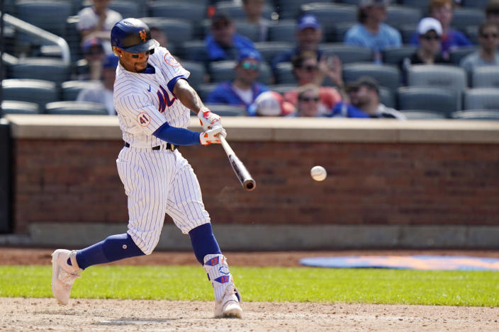New York Mets' Francisco Lindor hits an eighth-inning double during a baseball game against the Philadelphia Phillies, Sunday, June 27, 2021, in New York. (AP Photo/Kathy Willens)