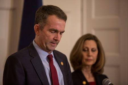 FILE PHOTO: Virginia Governor Ralph Northam, accompanied by his wife Pamela Northam announces he will not resign during a news conference in Richmond