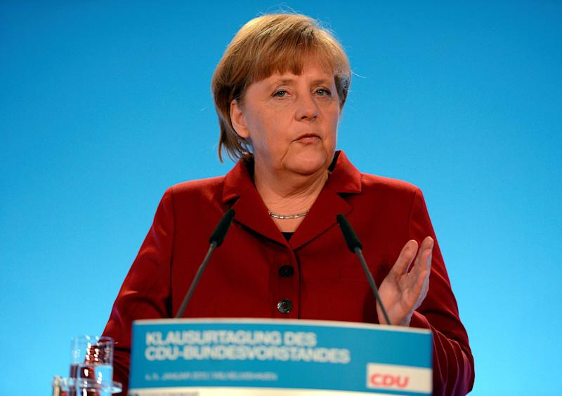 German chancellor Angela Merkel   delivers her speech at a party leaders' meeting in Wilhelmshaven, northern Germany Saturday Jan. 5, 2013. Chancellor Angela Merkel is highlighting Germany's economic strength and dismissing worries that her party could be dragged down by its struggling coalition partner as she kicks off campaigning for an important state election.  Merkel's center-right coalition faces a tough battle to extend its 10-year hold on Lower Saxony state in the Jan. 20 election. Polls suggest the center-left opposition has a good chance of winning - giving it a significant boost ahead of September national elections in which Merkel will seek a third term.   (AP Photo/dapd/ David Hecker)