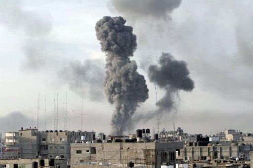 Smoke billows after Israeli air strikes near smuggling tunnels between the southern Gaza Strip and Egypt