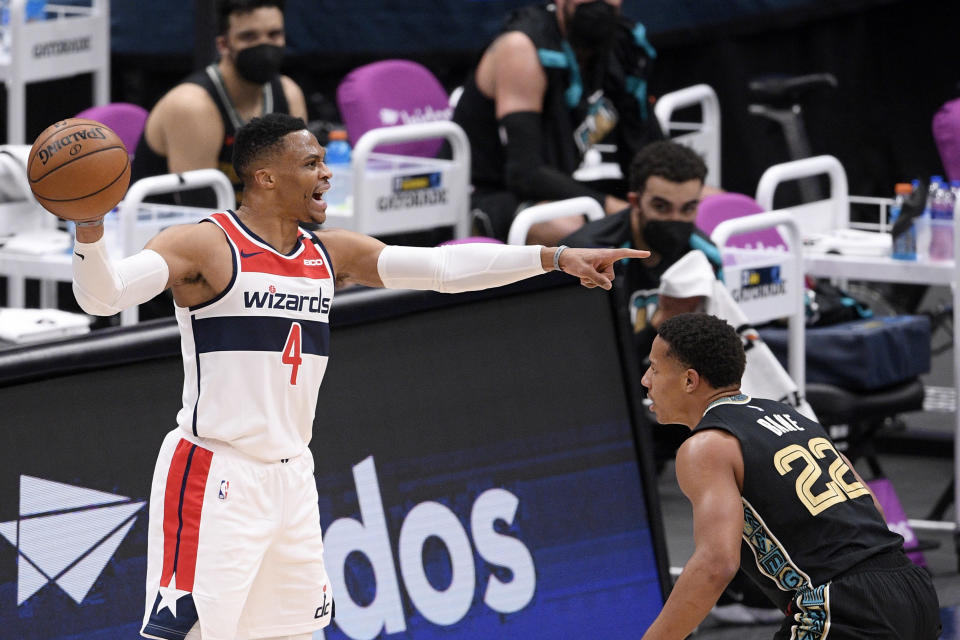 Washington Wizards guard Russell Westbrook (4) points during the first half of an NBA basketball game against Memphis Grizzlies guard Desmond Bane (22), Tuesday, March 2, 2021, in Washington. (AP Photo/Nick Wass)