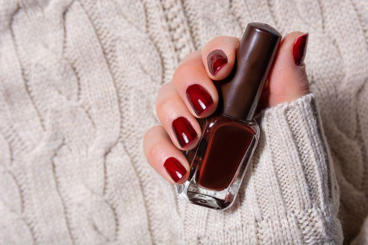 """<p>Polish up your look this winter season with pretty painted nails. Whether you're looking to make a statement with bold color (or even playful <a href=""""https://www.countryliving.com/diy-crafts/g5035/christmas-nail-art-ideas/"""" rel=""""nofollow noopener"""" target=""""_blank"""" data-ylk=""""slk:Christmas nail ideas"""" class=""""link rapid-noclick-resp"""">Christmas nail ideas</a> or <a href=""""https://www.countryliving.com/life/g25845353/valentine-nail-designs/"""" rel=""""nofollow noopener"""" target=""""_blank"""" data-ylk=""""slk:Valentine's Day nail ideas"""" class=""""link rapid-noclick-resp"""">Valentine's Day nail ideas</a>) or like to play it safe with neutral nails, we've rounded up our favorite winter nail polish colors for winter 2020-2021, both trendy and classics alike. </p><p>If you love the look and feel of your hands after a visit to the nail salon but would rather not get out, try your hand at a self-manicure. For a successful at-home experience, it's a <em>must</em> to trim cuticles, file nails into desired shape, and moisturize hands with lotion or oil. And if you want that fresh-from-the-nail-salon smooth finish, don't skip buffing the bumpy ridges from your nails' surface. It only takes a few minutes, and it makes a home mani look oh-so-professional.</p><p>Now for the fun part—color! From daring to demure, we've picked the best polishes for dark skin, fair skin, and every tone in between. Not convinced a color is right for you? Well, that's the fun of nail polish. If you don't like it, you don't have to live with it. Your next favorite winter nail polish color is just a tiny bottle away. And if you happen to spill—no worries! Here's <a href=""""https://www.countryliving.com/home-maintenance/cleaning/a29953182/how-to-get-nail-polish-out-carpet/"""" rel=""""nofollow noopener"""" target=""""_blank"""" data-ylk=""""slk:how to get nail polish out of carpet"""" class=""""link rapid-noclick-resp"""">how to get nail polish out of carpet</a>!</p>"""