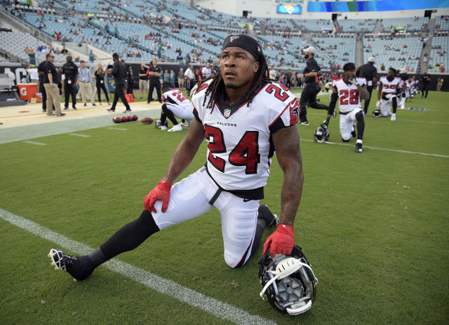 FILE - In this Aug. 25, 2018, file photo, Atlanta Falcons running back Devonta Freeman (24) stretches before an NFL preseason football game against the Jacksonville Jaguars in Jacksonville, Fla. Freeman has been ruled out for Sundays game against Carolina because of a knee injury, coach Dan Quinn said Friday, Sept. 14, 2018. (AP Photo/Phelan M. Ebenhack, File)
