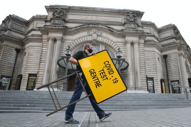 Signs are put in place at a new walk-through testing centre at the Usher Hall in central Edinburgh (Andrew Milligan/PA)