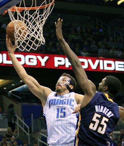 Orlando Magic's Hedo Turkoglu (15) gets past Indiana Pacers' Roy Hibbert (55) for a shot during the first half of Game 4 of an NBA first-round playoff basketball series, Saturday, May 5, 2012, in Orlando, Fla. (AP Photo/John Raoux)