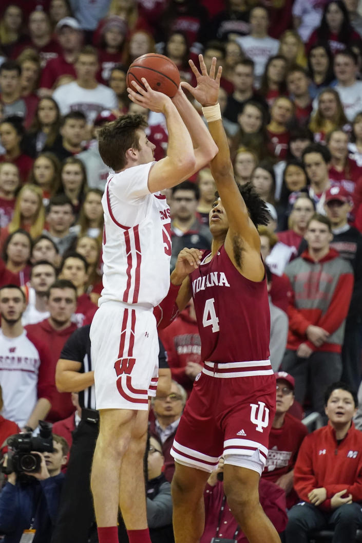 Wisconsin's Nate Reuvers (35) shoots against Indiana's Trayce Jackson-Davis (4) during the first half of an NCAA college basketball game Saturday, Dec. 7, 2019, in Madison, Wis. (AP Photo/Andy Manis)