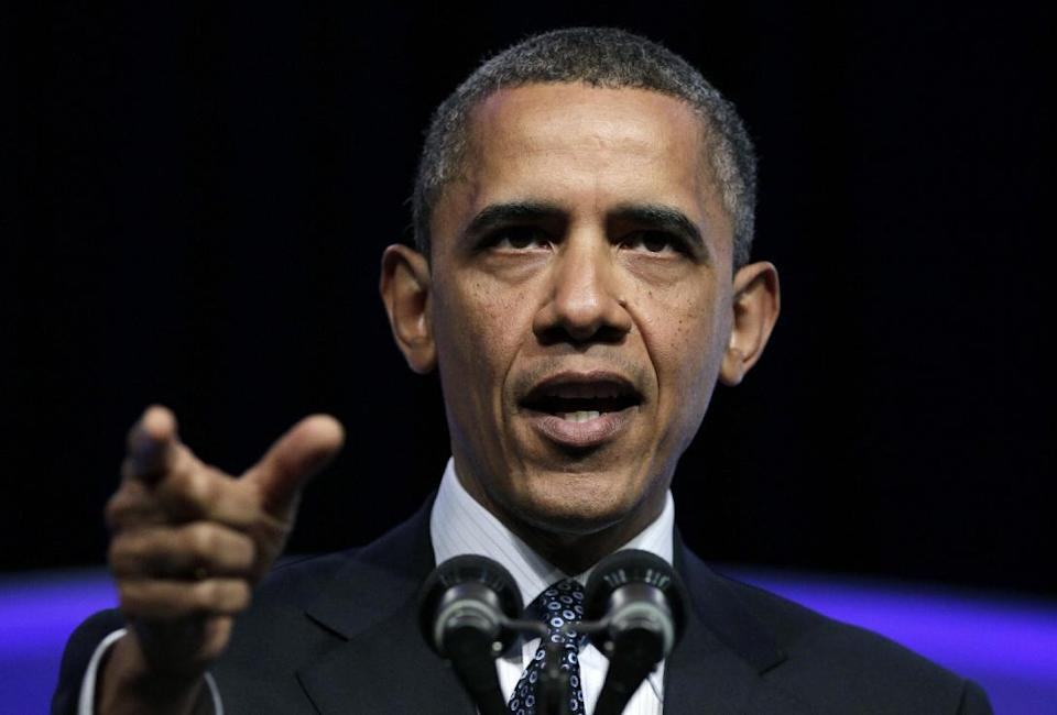 President Barack Obama gestures as he speaks at The Associated Press luncheon during the ASNE Convention, Tuesday, April 3, 2012, in Washington. (AP Photo/Carolyn Kaster)