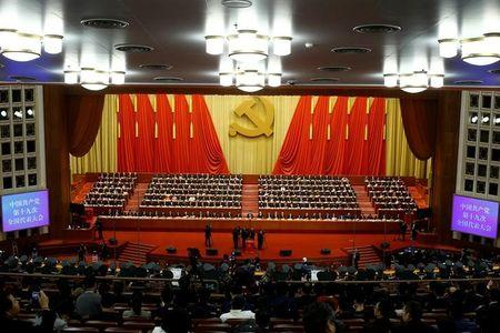 Delegates attend the closing session of the 19th National Congress of the Communist Party of China at the Great Hall of the People in Beijing