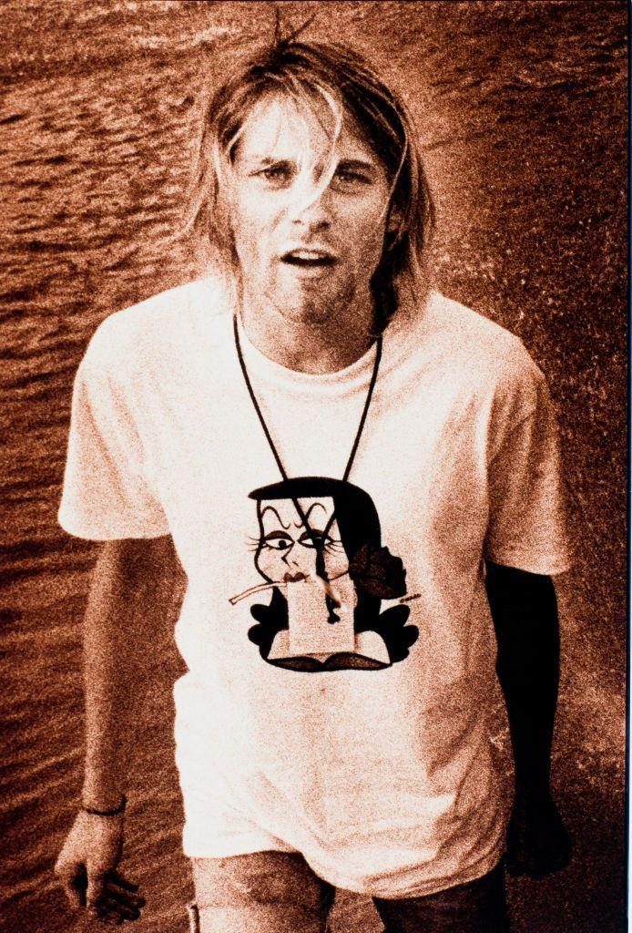 """<p>Kurt Cobain on tour in 1991. The band's first album, <em>Bleach, </em>reportedly only <a href=""""https://ultimateclassicrock.com/nirvana-bleach/"""" rel=""""nofollow noopener"""" target=""""_blank"""" data-ylk=""""slk:cost $606.17 to make"""" class=""""link rapid-noclick-resp"""">cost $606.17 to make</a>. </p>"""