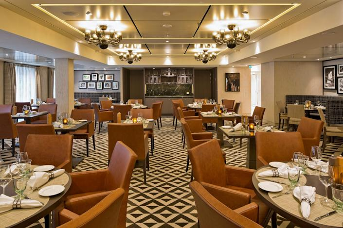 restaurant with brown leather seats and set tables