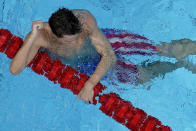 Robert Finke, of the United States, celebrates after winning the gold medal in the men's 1500-meter freestyle final at the 2020 Summer Olympics, Sunday, Aug. 1, 2021, in Tokyo, Japan. (AP Photo/Jeff Roberson)