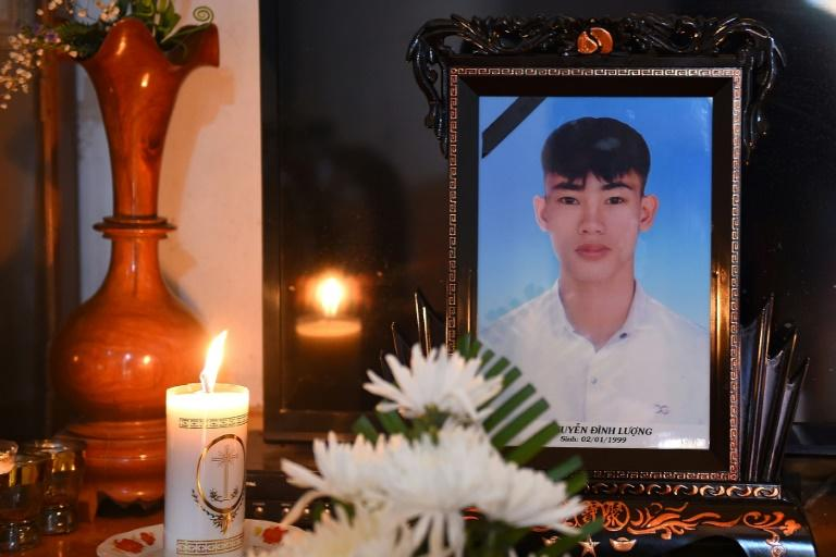 A portrait of 20-year-old Nguyen Dinh Luong, who is feared to have been among the 39 people found dead in a truck in Britain, is kept on a prayer altar at his house in Vietnam's Ha Tinh province on October 29, 2019