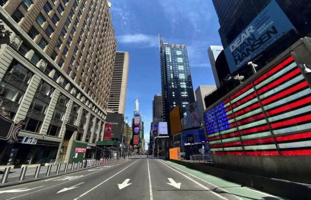 A nearly deserted 7th Avenue in Times Square is seen near midday during outbreak of the coronavirus disease (COVID-19) in New York