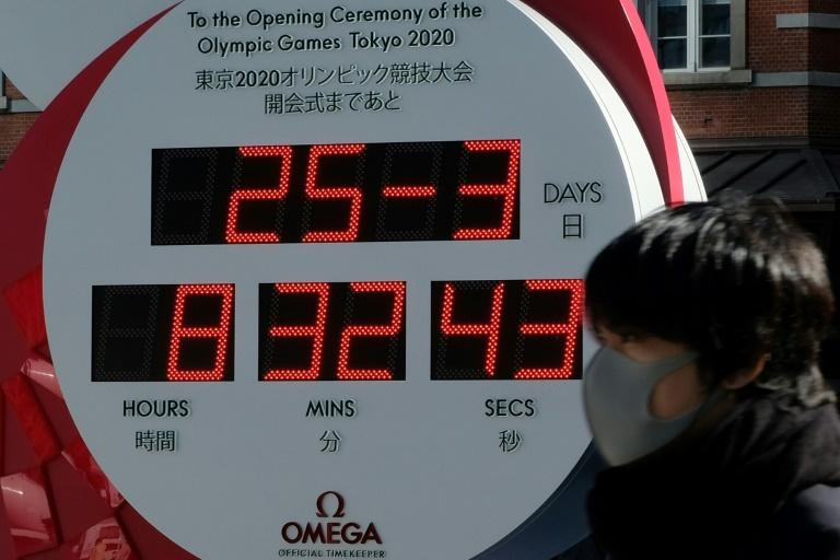 Countdown clocks for the Tokyo Games have been stopped, displaying only the date, after the decision to delay the 2020 Olympics