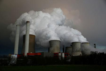 FILE PHOTO: Steam rises from the cooling towers of the coal power plant of RWE, one of Europe's biggest electricity and gas companies in Niederaussem, north-west of Cologne, Germany March 3, 2016.    REUTERS/Wolfgang Rattay/File Photo