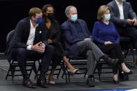 From left to right, former player Dirk Nowitzki, from left, his wife Jessica, former President George Bush and wife Laura Bush, watch as the Brooklyn Nets play the Dallas Mavericks in the first half of an NBA basketball game in Dallas, Thursday, May 6, 2021. (AP Photo/Tony Gutierrez)