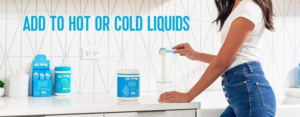 woman pouring collagen powder into drink